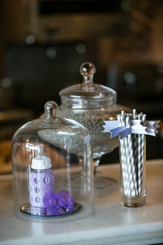 Simple Baby Shower Decor: Use coordinating baby bottles, pacifiers, etc! #babyshower #decor