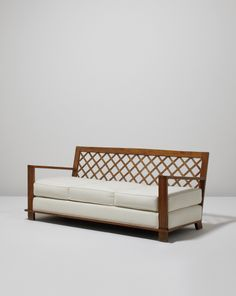 "PHILLIPS Auction:   JEAN ROYÈRE ""Croisillon Alexandrie"" sofa, ca. 1948 Oak, fabric. 36 x 75 7/8 x 33 1/2 in. (91.4 x 192.7 x 85.1 cm.) Estimate $18,000 - 22,000   SOLD FOR $35,000"