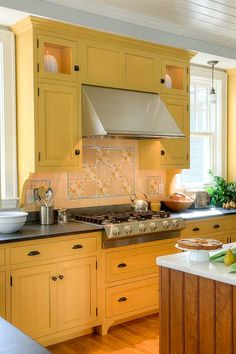 This bright and beautiful country style kitchen by Crown Point Cabinetry features traditional yellow kitchen cabinets and a contrasting wood island. Painting Kitchen Cabinets, Country Kitchen Cabinets, Oak Kitchen, Yellow Kitchen Cabinets, Yellow Country Kitchens, New Kitchen, Country Kitchen, Diy Countertops, Kitchen Design