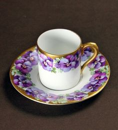 purple violets encircle both the demitasse cup and saucer It's Tea time Z. Art Antique, Antique Tea Cups, Vases, Teapots And Cups, Teacups, Cafetiere, China Tea Cups, My Cup Of Tea, Chocolate Pots