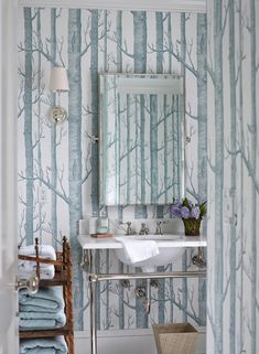 What a unique wall treatment in this bathroom! Everyone else in the room is made simple and sparse in order to keep the focus on the birch tree walls. Neat.