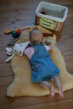 Ideas on treasure baskets. I love this as I generally believe toys are a waste of money for kids!