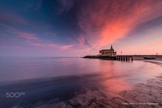 Caorle, sunset. - Sunset at Caorle beach, The Sanctuary of Our Lady of the Angel (Santuario della Madonna dell'Angelo). Region Veneto. Italy