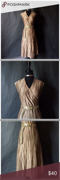 """Jones New York Gold Tone Dress This gold toned Jones New York dress is absolutely STUNNING! With its hidden gold design & beautiful fit, you will easily look like luxury without spending the price tag. This dress retails for $112.  The dress is a one piece, has a v-neck line, short sleeves and reached the mid calf (belt shown on photo is not included. Only for photo purposes only).   The dress is a size Large with the following measurements: Length 45"""" Bust 44"""" Waist 36""""   (This is a very…"""