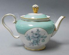"""Royal Tettau China Teapot is in good condition.     Features:      Green, White and Gold in color w/flower design     Serialized in gold, as well as the outer rim and handle are plated in gold makes this one of a kind.     Has Royal Tettau     Measures at 6 ¼"""" x 9 ¼"""" x 3 ¼""""     Handcrafted in Germany"""