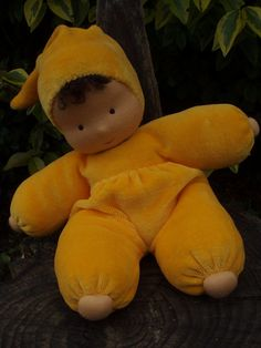 Sunflower is a 10 tall soft Waldorf doll. She has tanned skin colour, dark brown eyes, and a lovely warm yellow jumpsuit made of cotton velour.