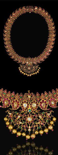 India ~ Tamil Nadu | Diamond, ruby and emerald set gold 'Manga Malai' necklace | 19th century | Est. 50'000 - 70'000£ ~ (Sept '14)