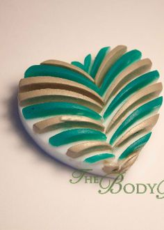 This creamy shea butter soap can be customized with two colors, perfect for your guests on your special day. Shown here with teal and gold.