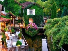 Hotel Le Moulin du Roc, France. Lounge in this charming hideaway among lush foliage.