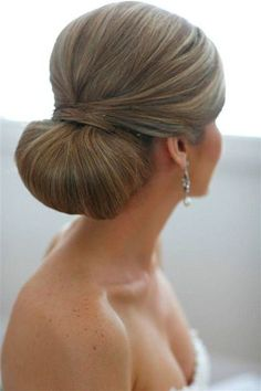 Chic chingion with sides pulled back and volume at the crown #MIBride #BridalBeauty