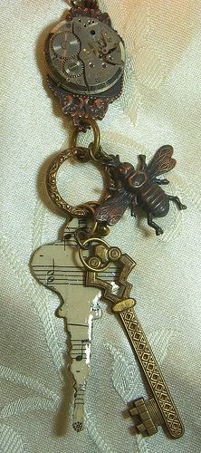 Use vintage scrip or vintage music sheets and adhere to old keys  mixed media jewelry pendant