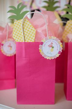 Favor gift bags from Flamingo + Flamingle Pineapple Party at Kara's Party Ideas. See more at karaspartyideas.com!