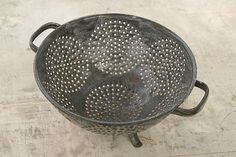This gray graniteware colander is great to hold some fruit on the table!