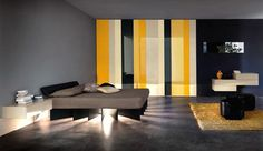 unusual-design-ideas-of-modern-bedroom-color-scheme-with-deep-grey-colors-wall-paint-also-combine-with-large-wardrobe-with-yellow-white-black-gloss-colors-and-wall-mounted-shelves-and-unique-shape-bla.jpg (5000×2900)