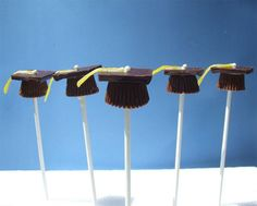 Graduation Dessert Idea. Stand apart your own party with the rest by these adorable candy graduation candy caps. Place Reece's cups on wax paper, insert lollipop sticks into the cup. Top the cup with square chocolate, glue candy belt and rainbow chip. http://hative.com/graduation-party-ideas/