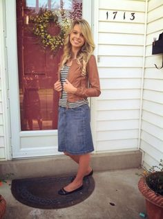 Perfect casual fall look. Jean skirt, striped top, and brown leather jacket.