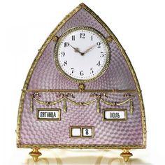 A RARE FABERGÉ GOLD, SILVER AND TRANSLUCENT ENAMEL COMBINATION DESK CLOCK AND CALENDAR, MOSCOW, 1899-1908 www.fairfieldauction.com