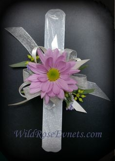 Simple inexpensive little girls wrist corsage.  lavender daisy on a silver slap bracelet.  #WildRoseEvents #weddingflowers #corsage