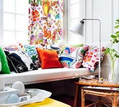colorful living room  LOVE!!! even the patterned curtains.