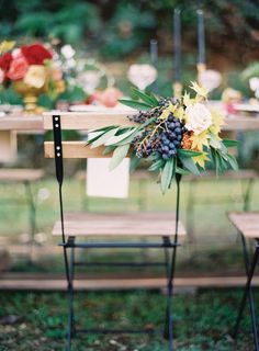 Autumn wedding chair decor with fruit, leaves and flowers. Florals by Rosegolden Flowers. Image by Odalys Mendez.