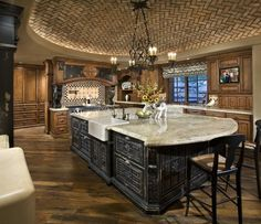 The brick ceiling, farmhouse sink, the sideways wood flooring - there's very little I don't love about this kitchen!!