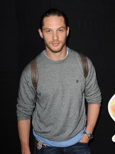 Tom Hardy gray shirt jeans leather strap back