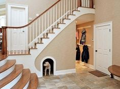 Dogs are people, too, which is why your dog should probably get his or her own little haven underneath the stairs. | 31 Insanely Clever Remodeling Ideas For Your New Home
