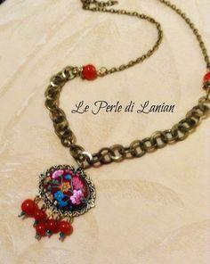 collana in pasta polimerica, con fiori a rilievo, con pietre dure