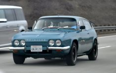 Just A Car Guy: Reliant Scimitar found on the I5 hauling a small kayak. Right hand drive