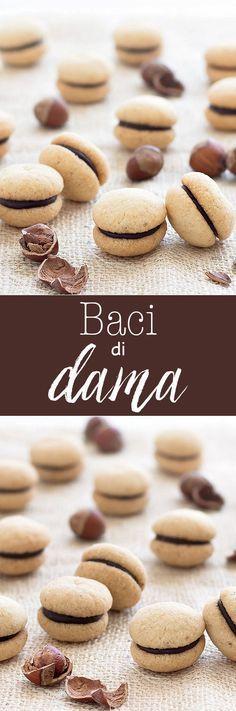 Baci di Dama ( Italian Hazelnut Cookies): buttery hazelnut cookies filled with a dollop of dark chocolate or Nutella recipe dessert easy Desserts Keto, Brownie Desserts, Mini Desserts, Easy Desserts, Delicious Desserts, Dessert Recipes, Plated Desserts, Italian Cookie Recipes, Italian Cookies