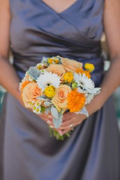 Orange and white bridesmaid bouquet.  www.thebackyardgardener.net  Medcalf Photography