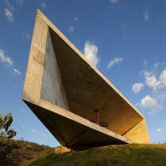 Skewed concrete chapel by EMC Arquitectura  balances over a mountainside in El Salvador
