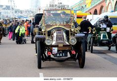 AA 1 and other veteran motor cars from pre-1905 arriving in Brighton at the end of the London to Brighton Veteran - Stock Image
