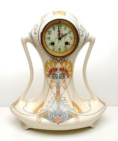 Earthenware mantleclock with enamelled dial and Jugendstil decoration Modelno.82 design Klaas Vet executed by Fayencefabriek Arnhem / the Netherlands 1903-'15 painted by H.P.M.Intres