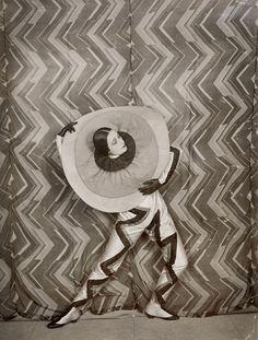 Wearing the Pierrot-Éclair costume designed by Sonia Delaunay, on the set of René Le Somptier's film Le P'tit Parigot, 1926
