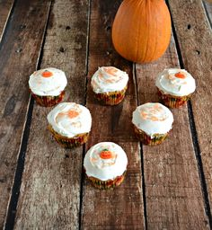 Delicious spiced Pumpkin BUtterscotch Muffins with Caramel Forssting and sprinkles!