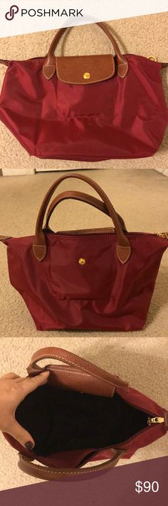 Longchamp Le Pliage Longchamp Le Pliage (small) bag purchased from Nordstrom about a year ago. Beautiful burgundy color, smaller straps (ideally carried by the forearm, and gently used (maybe a total of three times). Great and durable bag, just too small for me. Retails at $115. Longchamp Bags Mini Bags