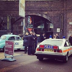 Police Cars of the 70's, the Morris 1000 Minor left and the Rover SD1 V8 on the right, a case where Dixon meets the modern Metropolitan force.
