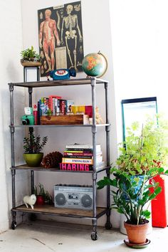 rack planter as bookshelf. urban outfitters home por todd selby