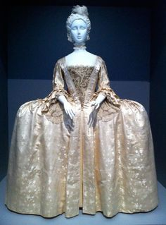 Robe a la Française, England 1765 -- silk satin with weft-float patterning silk passementerie. Stomacher, European 1725-75 -- silk satin with metallic thread embroidery.