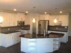 White maple kitchen with black granite