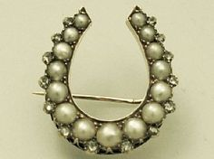 A fine antique Victorian pearl, diamond and 15 carat yellow gold brooch in the form of a horseshoe; part of the AC Silver jewellery range  http://www.acsilver.co.uk/shop/pc/0-38-ct-Diamond-Pearl-and-15-ct-Yellow-Gold-Brooch-Horseshoe-Shape-Antique-Victorian-87p3095.htm