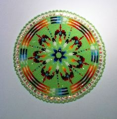 Water bird medallion, Native American beadwork--this looks like it glows with hidden knowledge--