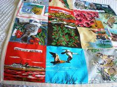 A patchwork tea towel quilt.  What a wonderful colourful   idea.