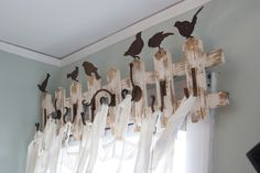 I love this a vintage pocket fence with hooks and birds used as valance for curtains