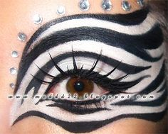 Creative black and white Zebra themed fantasy eye make-up with a bejeweled brow.
