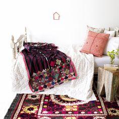 Bohemian bedroom with gypsy rabari embroidered blanket