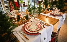 dropped napkins super pretty, also layered plates and evergreens everywhere