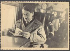 this item is sold only as a historical collectible from WWII without endorsing or excusing the actions of the Nazi Third Reich. Incredibly rare original world war 2 era photograph of Adolph Hitler reading a book while flying on his private airplane Thousands of these German photographs were obtained when the Soviet (Russian) forces took control of Hitler's compounds in Germany at the end of World War 2 This photograph has the ORIGINAL NKVD (The NKVD were prior to the KGB) STAMP