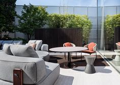 "Minotti Outdoor Collection | Bellagio Lounge ""Outdoor"" table, Aston ""Cord"" lounge outdoor chair, Rodolfo Dordoni design"